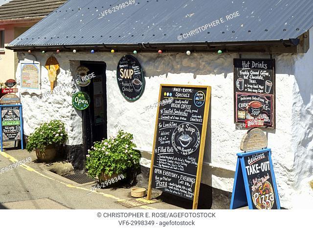 Colourful menu blackboard menu notice boards on a quaint cafe at Coverack, Cornwall, UK