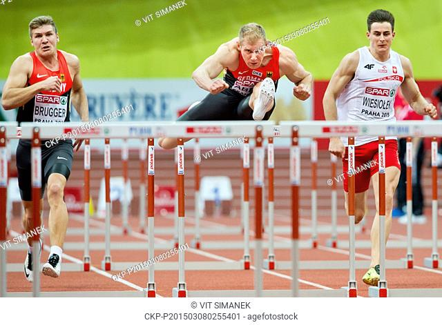 From left Germany's Mathias Brugger and Arthur Abele and Poland's Pawel Wiesiolek clear a hurdle in the 60m hurdles of the men's heptathlon during the European...