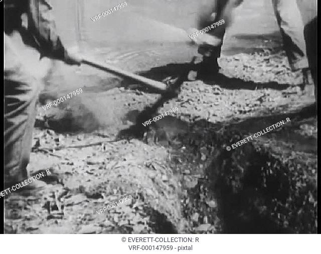 Workers digging an irrigation canal
