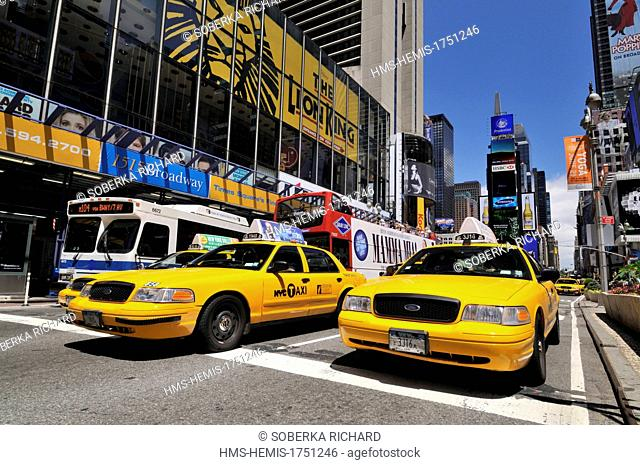 United States, New York, Times Square, yellow cab and buses in traffic