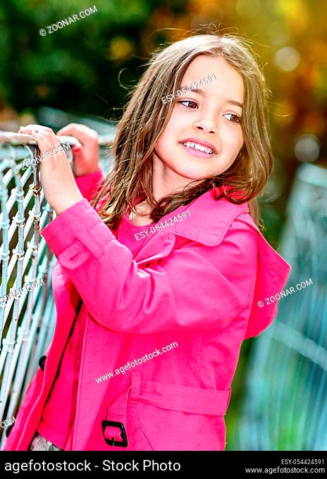 portrait of happy cute child with garden on background