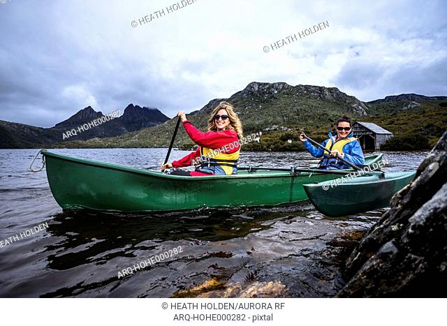 Canoeing around the famous boat shed on Dove Lake in Tasmania's Cradle Mountain, Lake St Clair National Park