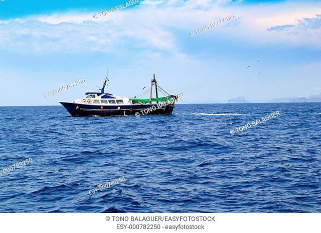 fishing trawler professional boat working in blue ocean sea