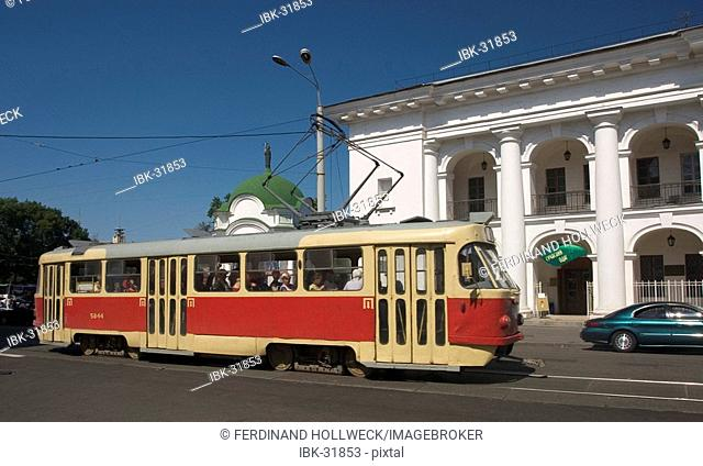 Ukraine Kiev district Podil Kontraktova Place oldest place of town tram and cars in background historical building Hostynnyi Dvir 1804 used for trade and fares...