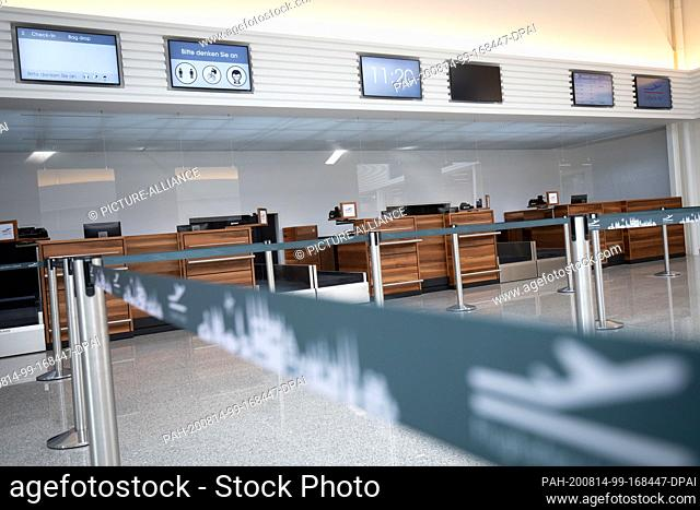 14 August 2020, Schleswig-Holstein, Lübeck: The check-in counters of Lübeck Air in the departure terminal of Lübeck Airport
