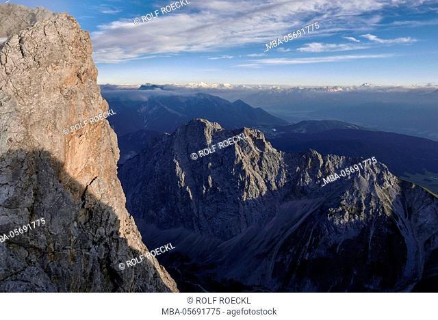 rock Storm at the Schüsselkarspitze west ridge, Wetterstein Range, view at Gehrenspitze and Zillertaler alps and Kalkkögel and hawk