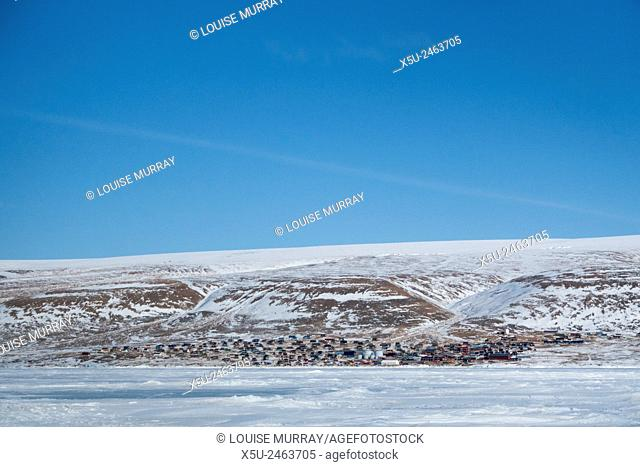 Village of Qaanaaq from the sea ice. Qaanaaq is one of the most northerly human settlements on the planet and is home to 656 mostly Inuit people