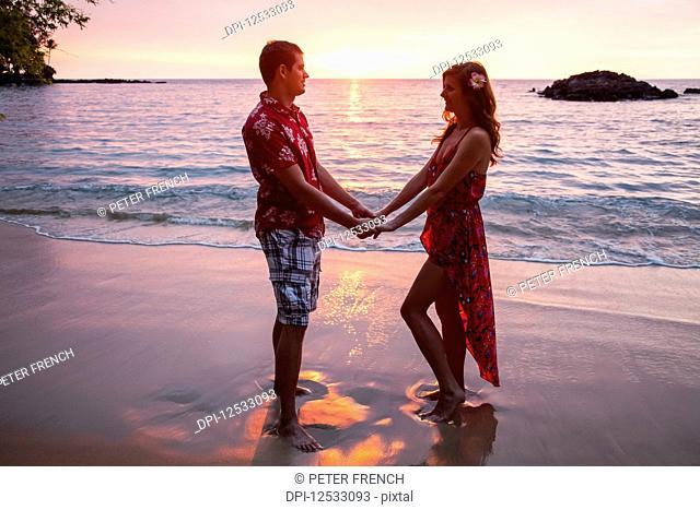 Honeymoon couple at Wailea Beach, Big Island Of Hawaii; Island of Hawaii, Hawaii, United States of America
