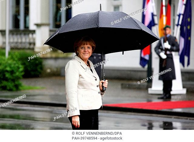 German Chancellor Angela Merkel awaits the arrival of Dutch Prime Minister MarkRutte before the first German-DutchCabinet Meeting in Kleve, Germany
