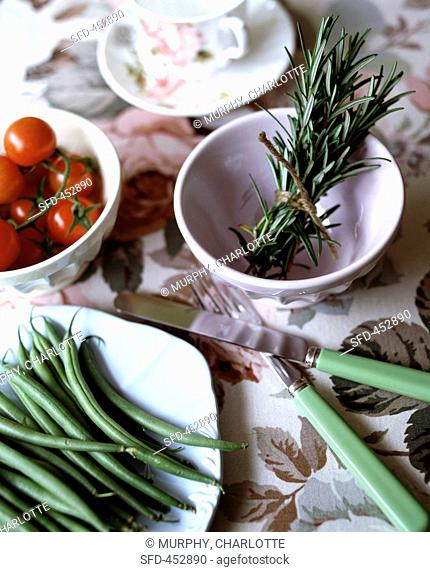 An arrangement of green beans and rosemary