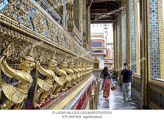 Tourists, at Emerald Buddha Wat Phra Kaeo temple, Grand Palace, Bangkok, Thailand
