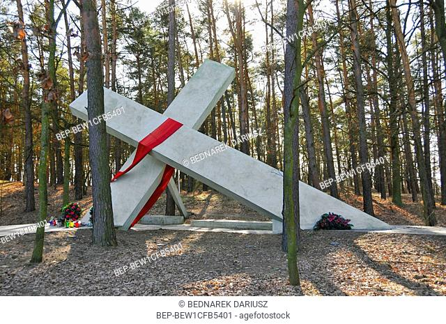 Overturned cross and stone, monuments at the place where Jerzy Popieluszko was kidnapped by Security Service of the Ministry of Internal Affairs on October 19