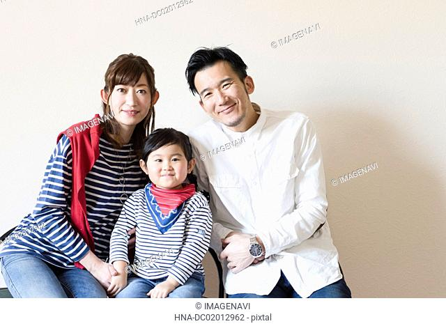 Portrait of three member of family