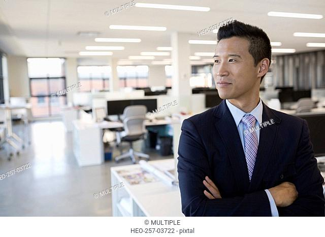 Portrait confident businessman in office