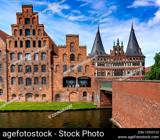 Lubeck, S-H / Germany - 9 August 2020: historic red brick buildings and the Holstentor city gate in Lubeck