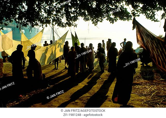 silhouettes at border of Mahanadi river at Sonpur, India