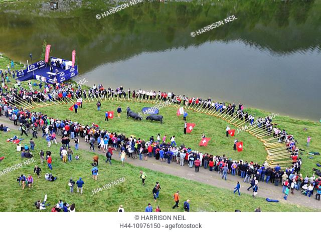 NENDAZ, SWITZERLAND - JULY 27: Aerial view of all contestants playing together by the lake at the finals of the 13th International Festival of Alpine horns :...