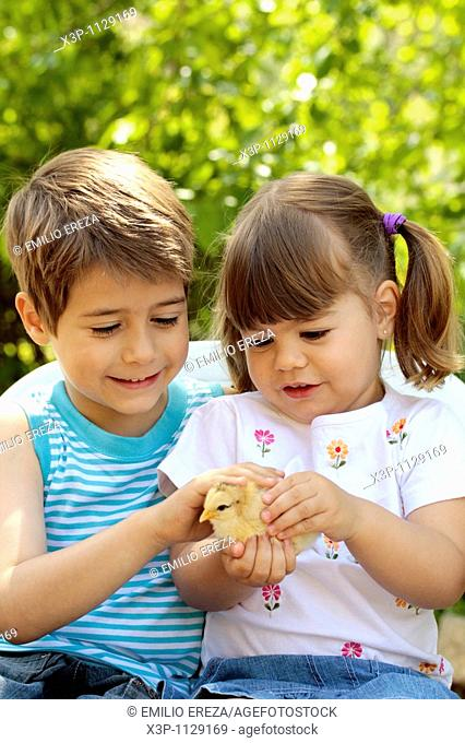 Kids with chick