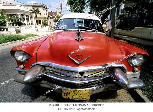 US-vintage car with a taxi sign in the window, parking at the roadside, Cadillac Series 62, Havana, Cuba, Caribbean