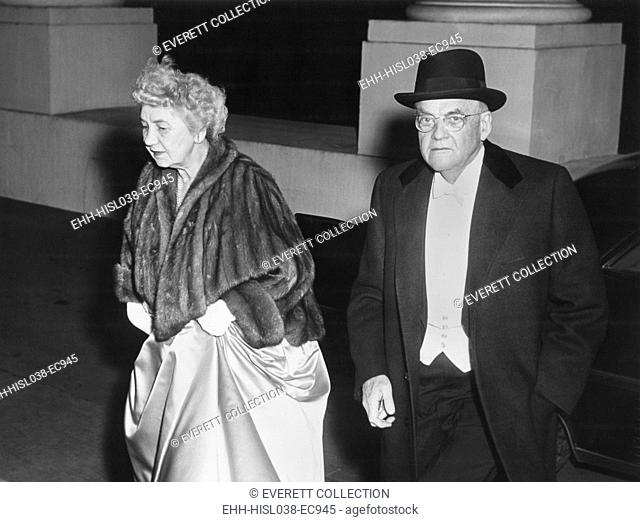Sec. of State John Foster Dulles and his wife, arriving at state dinner for Queen Elizabeth II. Oct 17, 1957. - (BSLOC-2014-16-137)