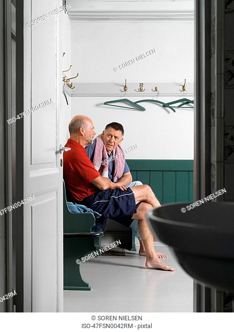 Older men sitting in locker room