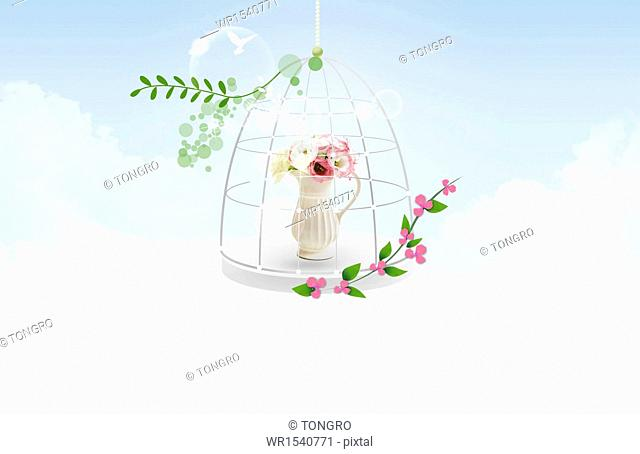 a bunch of flowers in a cage
