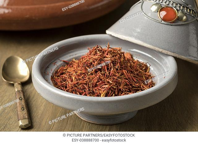 Traditional bowl with orange dried Moroccan saffron