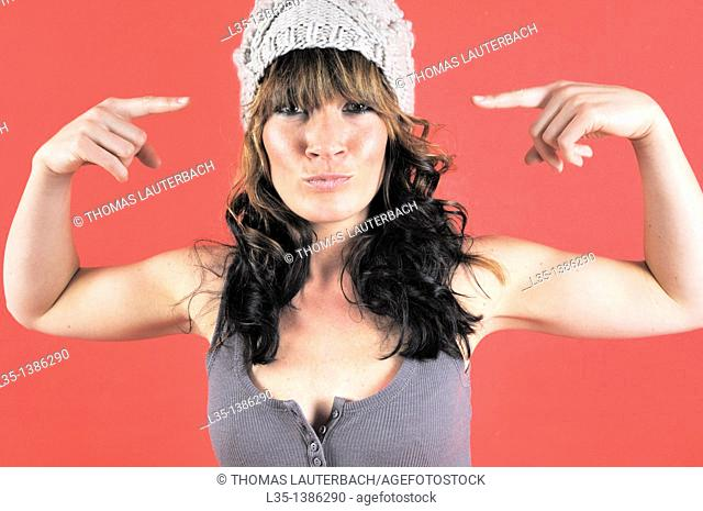 Young woman with hat get up to nonsense