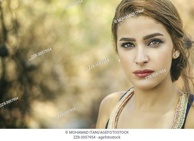 Portrait of a beautiful woman staring outdoors