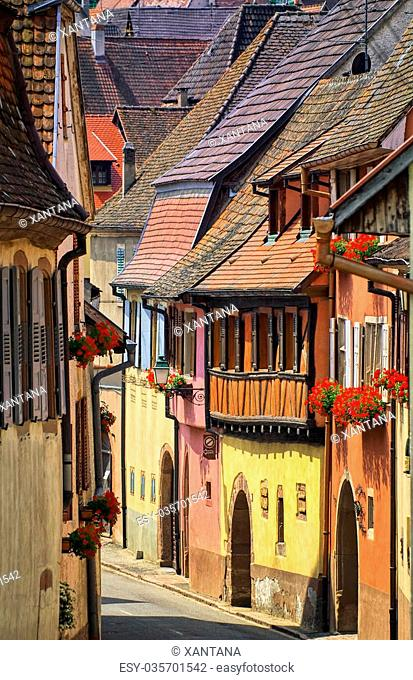 Narrow colorful street in Kayserberg village by Colmar, Alsace, France