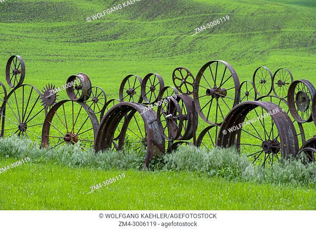 Old wagon wheel fence at the Dahmen Barn near Uniontown in the Palouse, Eastern Washington State, USA