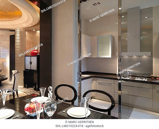 Dining table and kitchen in modern home