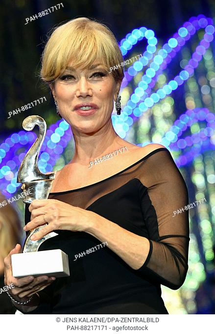 Italian actress Nancy Brilli poses with her award at theItalian film ball 'Notte delle Stelle' held during the 67th International Berlin Film Festival