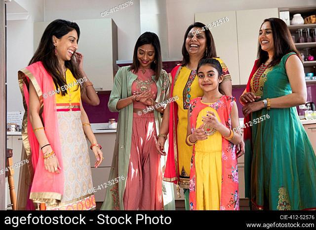 Happy multigenerational Indian women in traditional saris