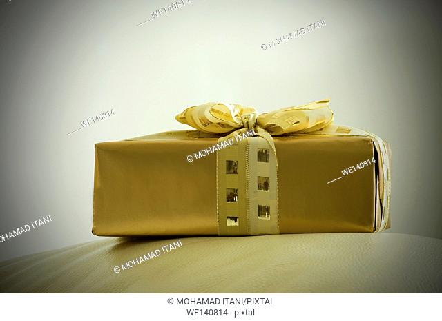 Side view of a golden gift box