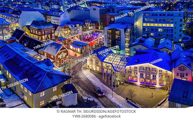 Aerial view of downtown Reykjavik during Christmas, including a small outdoor skating rink. This image is shot with a drone