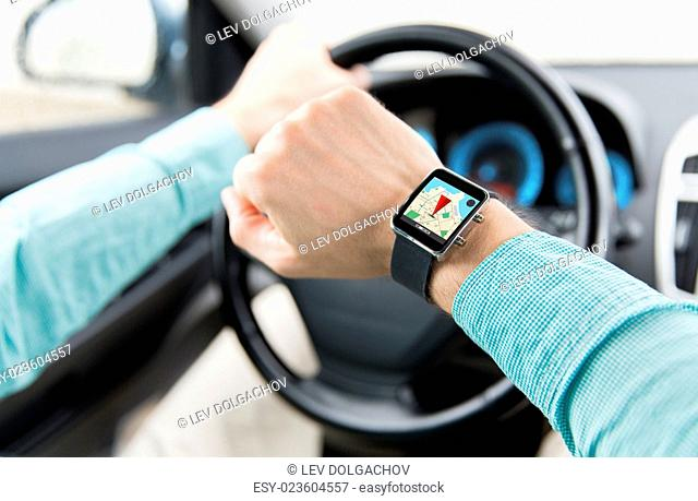 transport, business trip, technology, navigation and people concept - close up of man with smartwatch driving car and using gps navigator