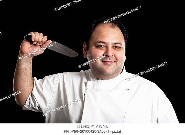 Portrait of a chef holding a knife