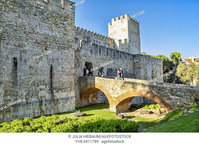 Visitors crossing the bridge of S. Jorge castle in Lisbon, Portugal