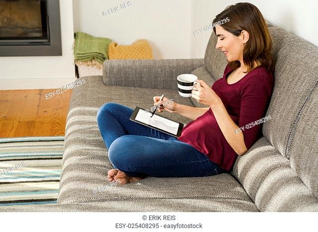 Beautiful woman at home drinking a cup pf tea