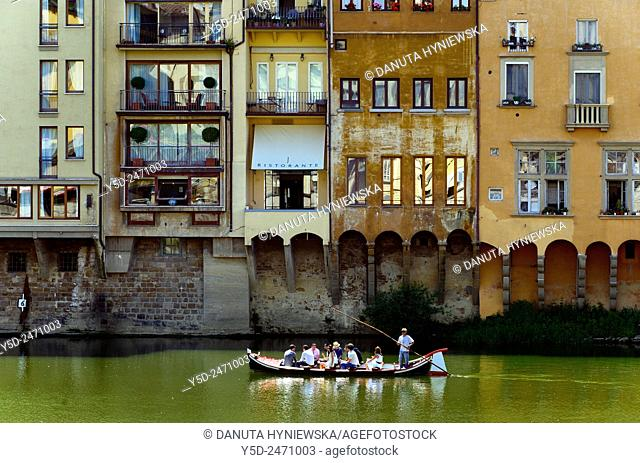 touristic boat on Arno river, old town of Florence, Tuscany, Italy