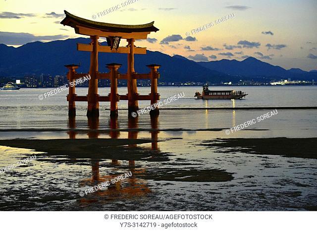 The floating Miyajima torii gate of Itsukushima Shrine at sunset,UNESCO,Miyajima island,Western Honshu,Japan,Asia