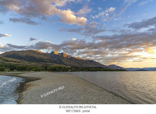 Clouds in the sky above Lake Wakatipu and mountains at sunset. Glenorchy, Queenstown Lakes district, Otago region, South Island, New Zealand
