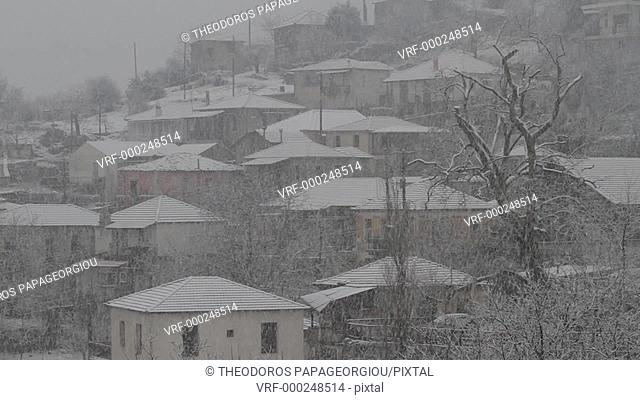 Snowing at Chrysovitsi village. Arcadia, Peloponnese, Greece
