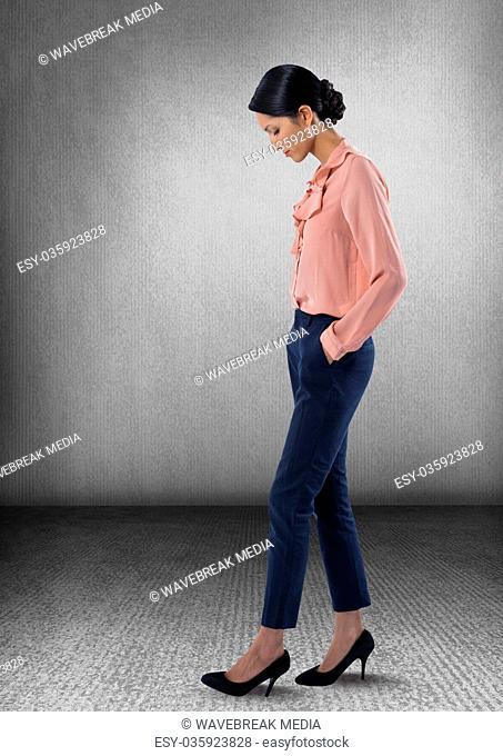 Stylish Businesswoman posing looking down at foot