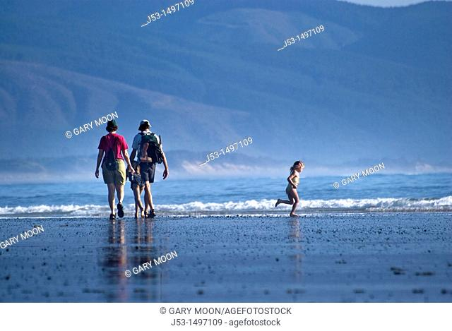 Family enjoying summer afternoon at an Oregon beach