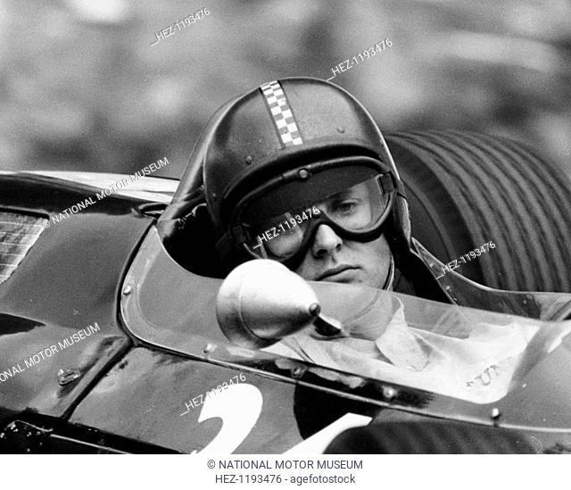 Chris Amon in a Lotus 25-BRM V8, French Grand Prix, Rouen, 1964. Amon rounds La Nouveau Monde hairpin bend at the Rouen circuit during the French Grand Prix