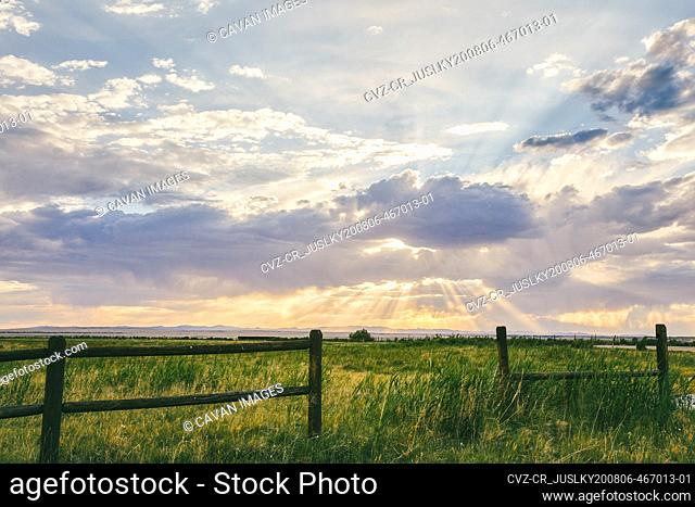 Sunset over field with fence on a road trip through Meadow, Utah