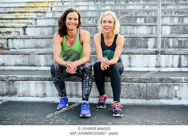 Female friends on stadium benches