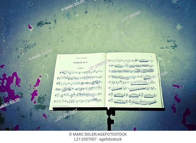 Sheet music. Metal music stand with music score on it